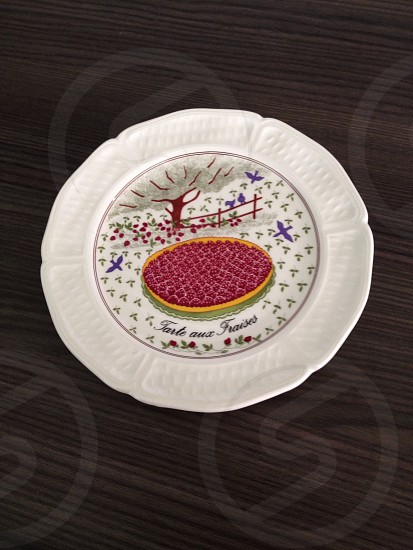 white plate with strawberry pie print photo