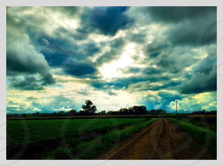 Dirt road Country Rd. Sunset cornfields crops combine sunset photo