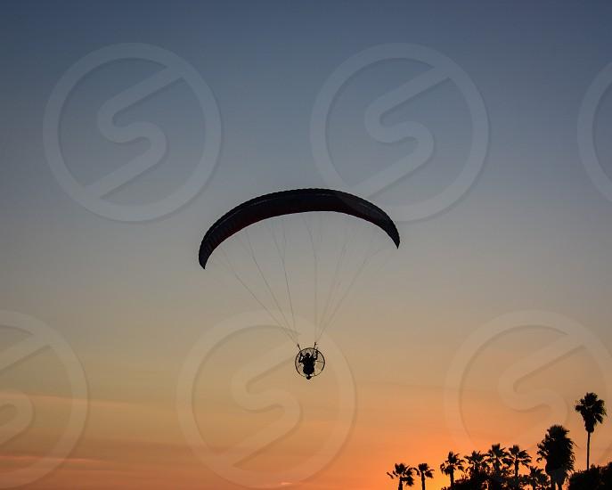 parachute silhouette photo