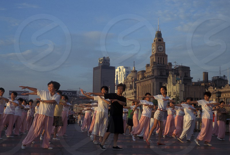 people make tai chi in the morning on the bund in the City of Shanghai in china in east asia.  photo
