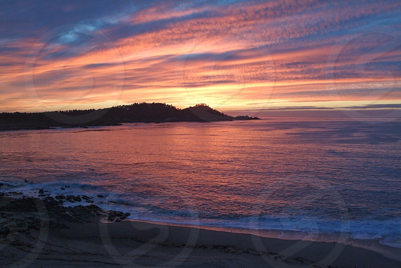 Fiery Sunset over Point Lobos near Carmel California.  photo