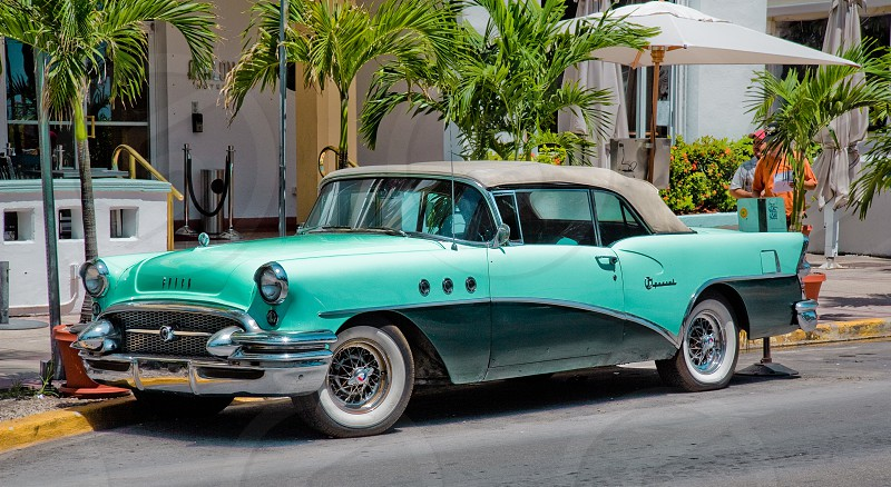 Vintage car parked on the street in Miami Florida USA. photo