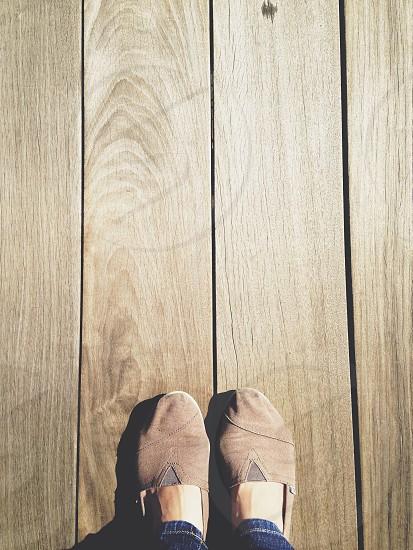 brown toms on brown wooden floor photo