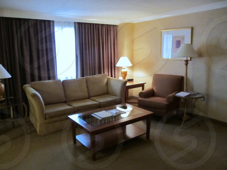 Hotel suite living room with sofa and chair photo