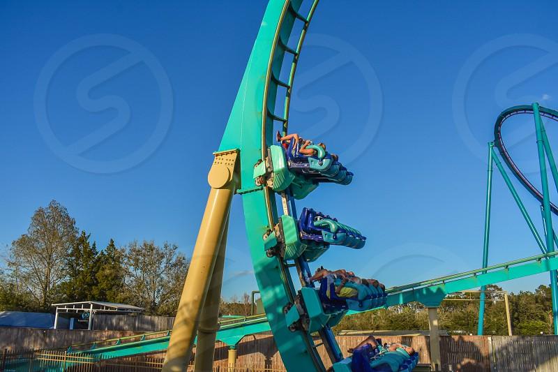 Orlando Florida . February 26  2019.  People enjoying terrific Kraken rollercoaster at Seaworld Theme Park (1) photo