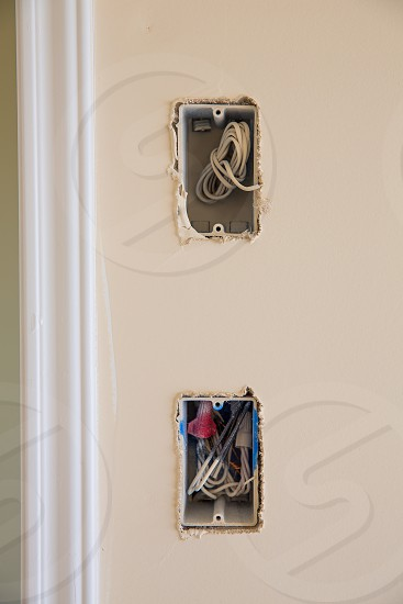 electrical box for switch and plug with wires while new house construction photo