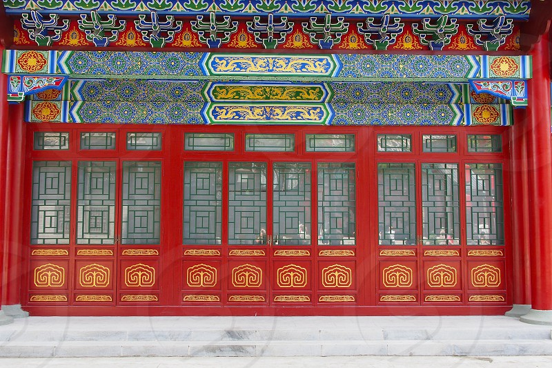 Row of doors in China. Geometric patterns. Red. Saturated colors. Intricate detail. photo