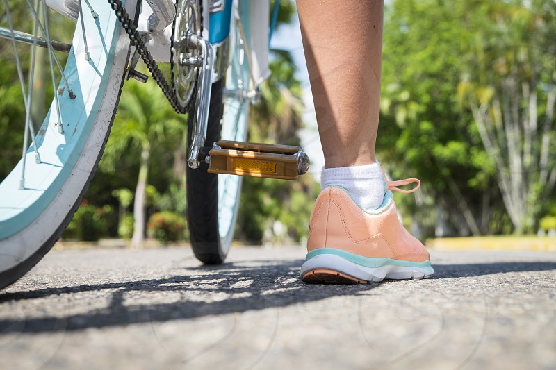 Close up of girl's foot about to ride a bicycle. Female teenager 13 years Nayarit Mexico photo