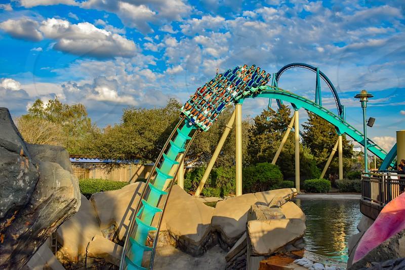 Orlando Florida. March 05 2019. People having fun Kraken rollercoaster at Seaworld Marine Theme Park (12) photo