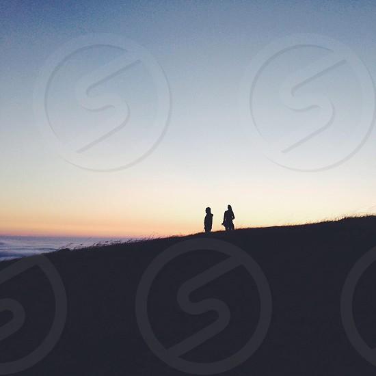 2 person in the hill silhouette  photo
