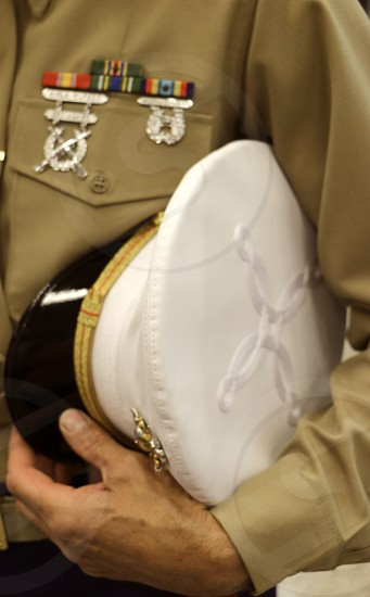 A man in uniform stands at ease. photo