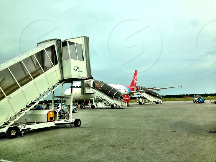 LisAm airport ground transportation plane jet bridge photo