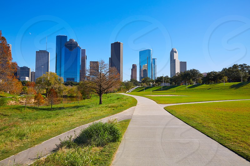 Houston skyline in sunny day from park grass of Texas USA photo