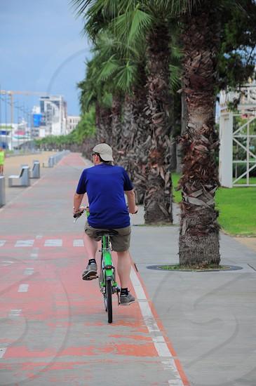 man riding a bike photo