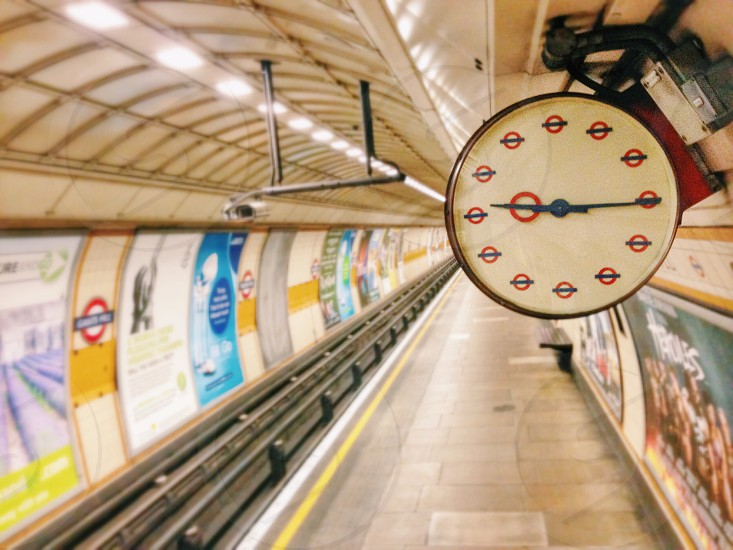 white and red trench station clock time set at 9:15 photo