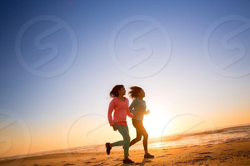 beach sand blue sky sunset run runner fitness outdoor photo