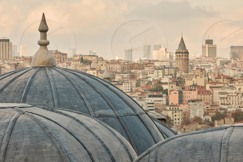 close-up of the mosque dome view of the city the Galata tower in the distance Istanbul Turkey photo