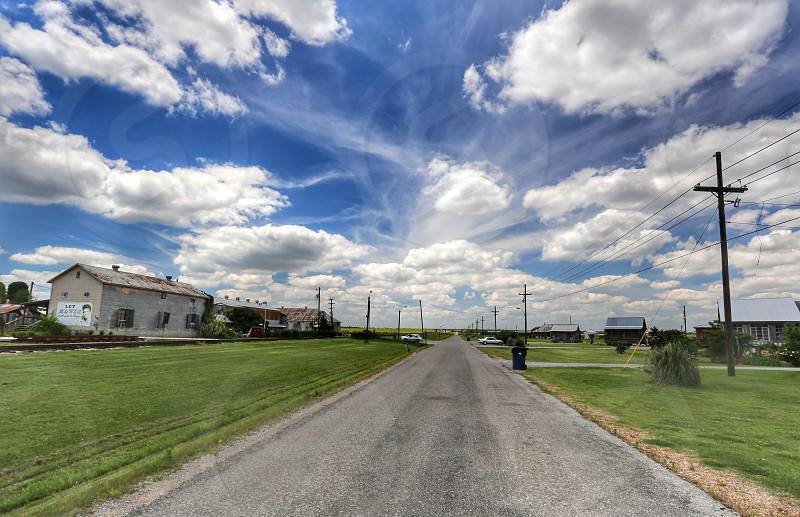 Delta sky clouds dramatic color landscape south transportation road photo
