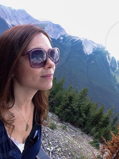 woman wearing brown frame sunglasses looking up photo