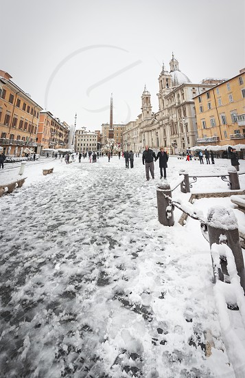 Rome Italy february 26th 2018: Piazza Navona in Rome covered with snow with citizens and tourists walking in wonder after the unusual snowfall of February 26th 2018 photo