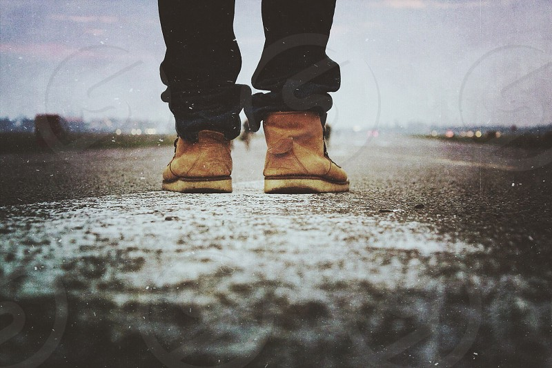 person wearing brown boots photo