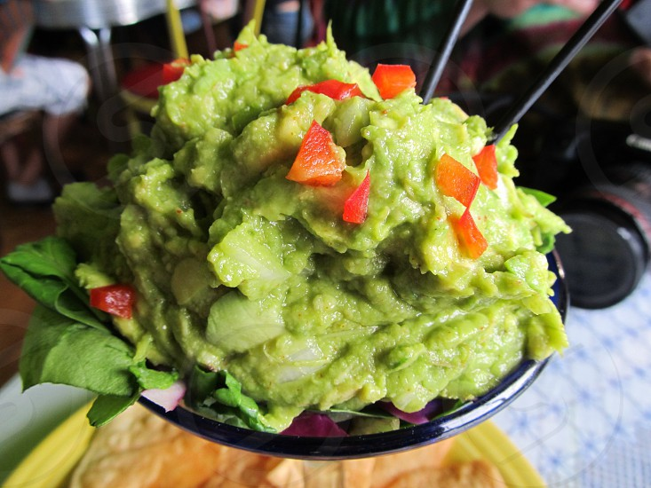 Guacamole with tomatoes in glass photo