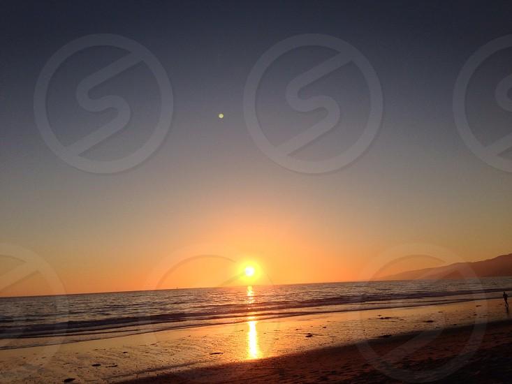 sunset at the beach scenery photo