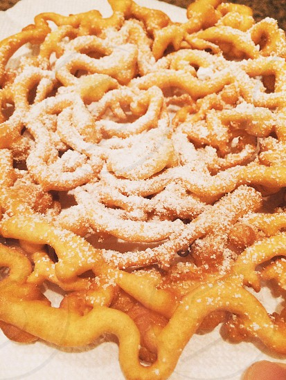 brown spiral pastry with white sprinkled sugar photo