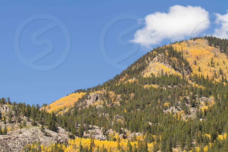 Mountain with lone cloud in fall photo