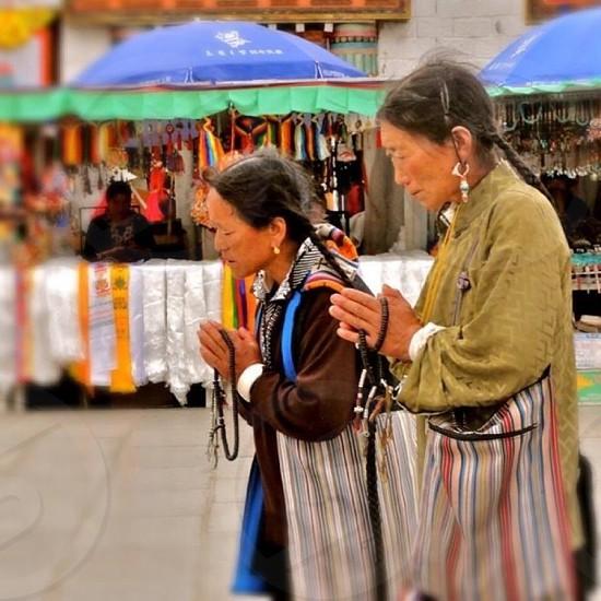 2 woman praying photo
