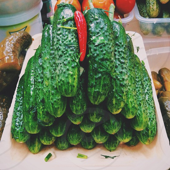 green cucumber on piled photo