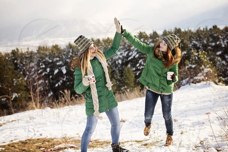 girls winter snow vacation travel freedom holiday enjoy happy fun smile play photo