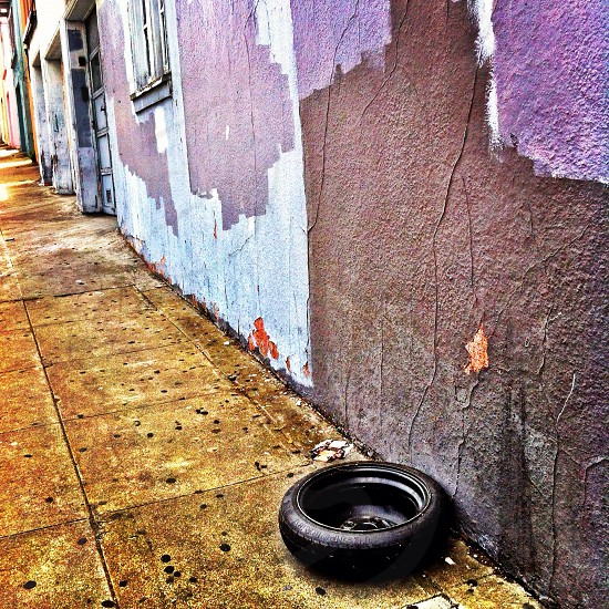 black rubber tire beside the brown painted wall photo