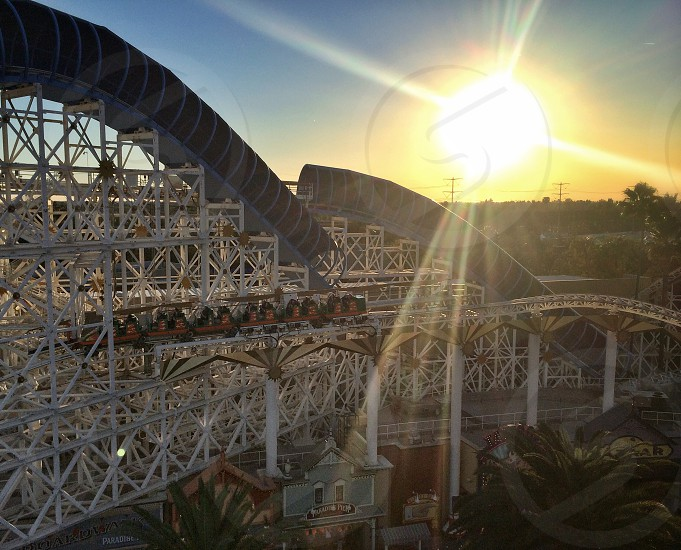 aerial view of the roller coaster track at sunset photo