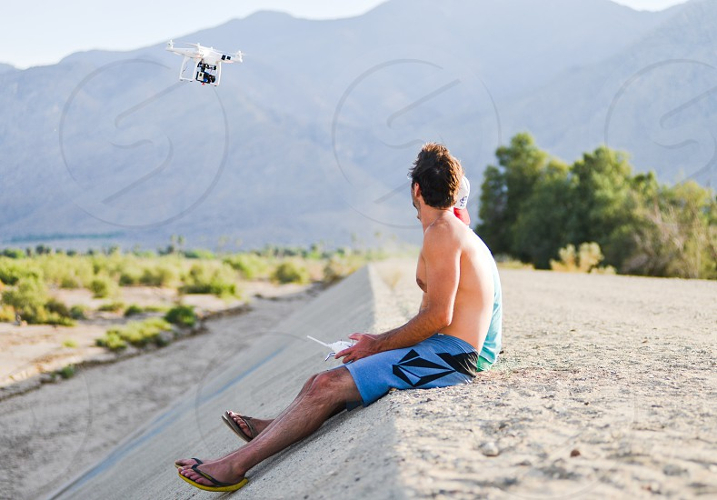 friends outdoors flying rc drone surveillance photo
