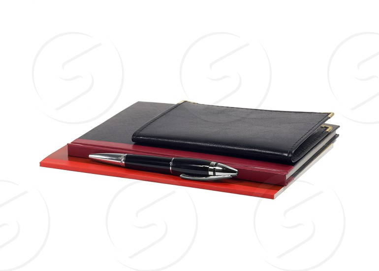 assorted notebooks and fountain pen isolated on white background photo