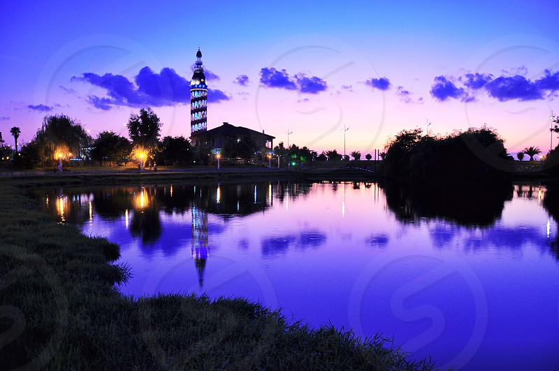 blue lighted tower building photo