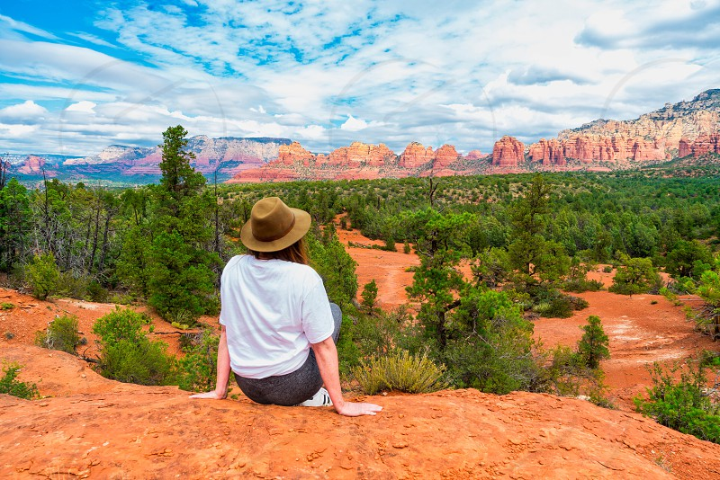 Woman enjoying a spectacular desert view. photo