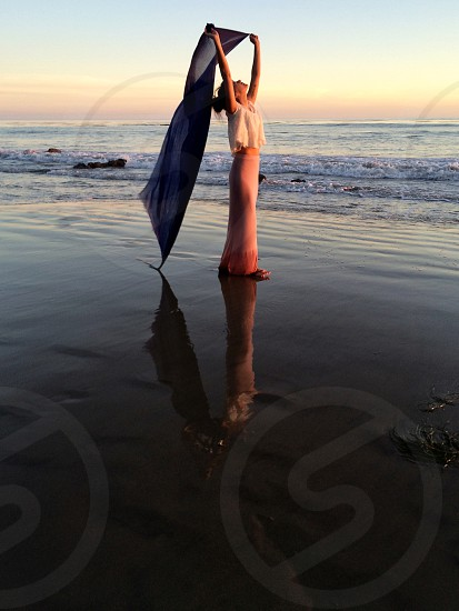 woman holding blanket on beach photo