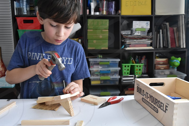 Creative kids building wood hammer  photo
