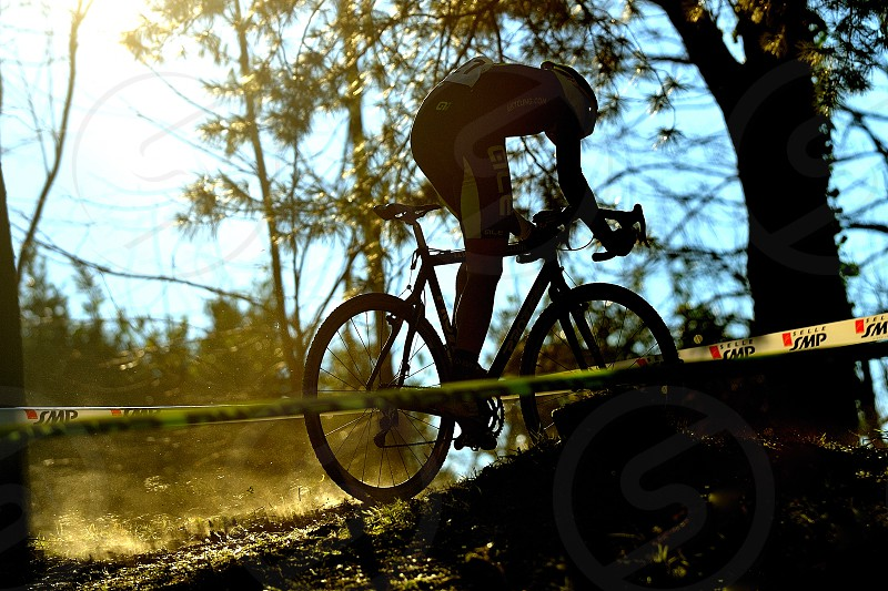 Cross country biker climbing cyclocross race in Italy photo