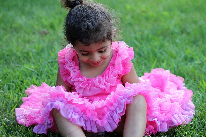 Brown Haired Girl Wearing Pink Tulle Dress photo