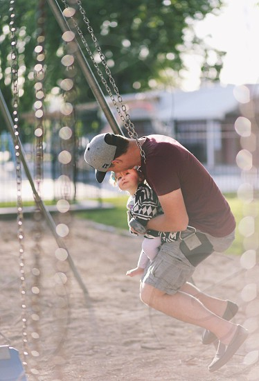 Swings with dad photo