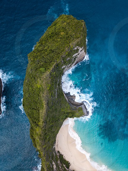 Aerial view of one of the most popular beaches in Nusa Penida Bali. Amazing colors! photo
