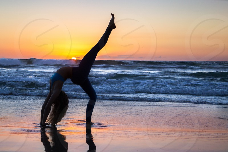Yoga silhouette beach  photo