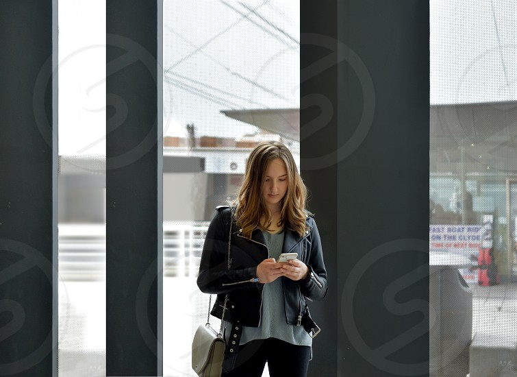 Young woman using mobile phone in a contemporary environment. photo