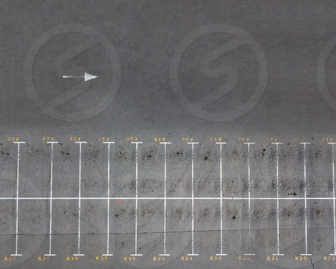 Aerial view from the drone of an empty parking lot with pointing markings. Top view photo