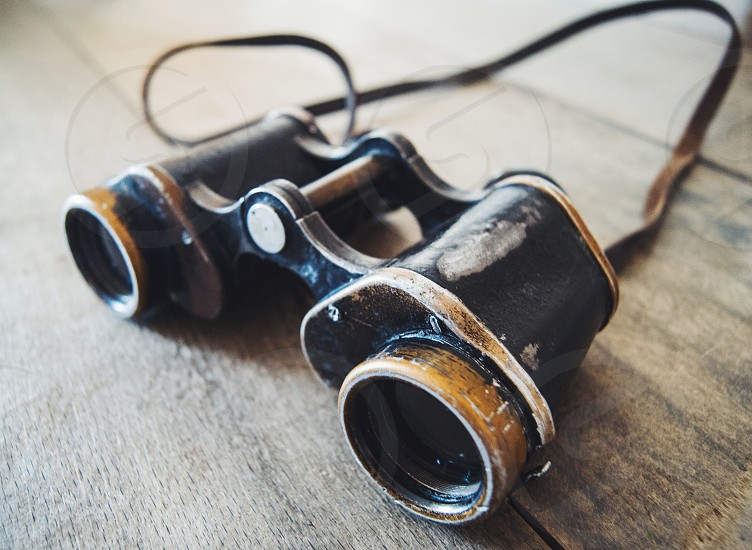 Black vintage binoculars. photo