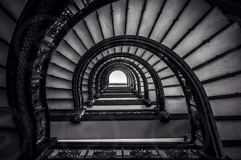 black and white photo from top of spiral stair case photo