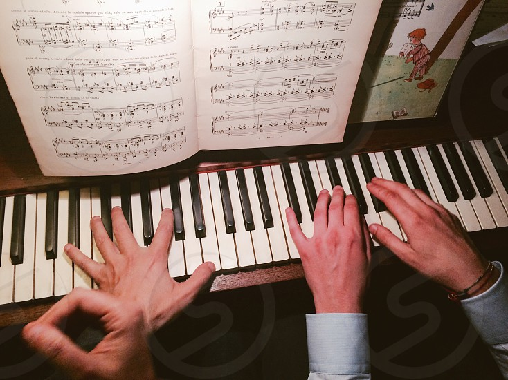 Piano pianists 4 hands playing classic music classical background  photo